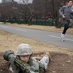 Boston, MA, Feb. 16, 2012 - Members of the Boston University Reserve Officers' Training Corps run a training exercise on the Charles River esplanade Thursday afternoon. Here, a jogger reacts ...